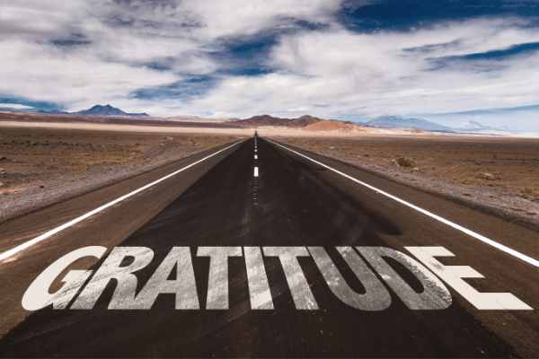 The word gratitude painted on a street.