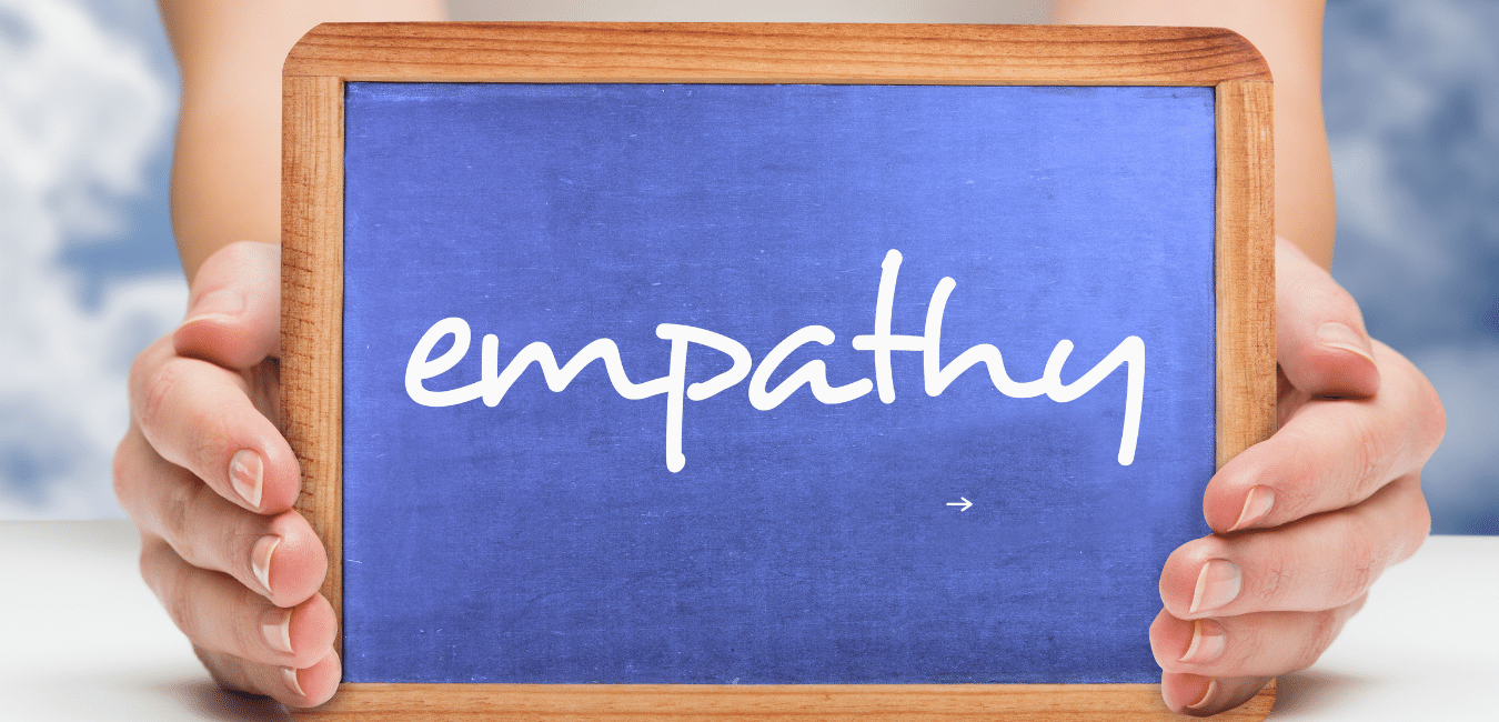 woman holding board that says empathy
