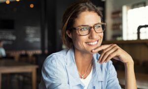 woman sitting at table thinking about self-care and work-life balance