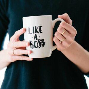 Woman holding mug that says Like a Boss